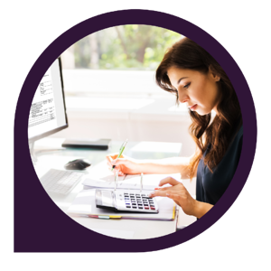 woman working at desk using calculator